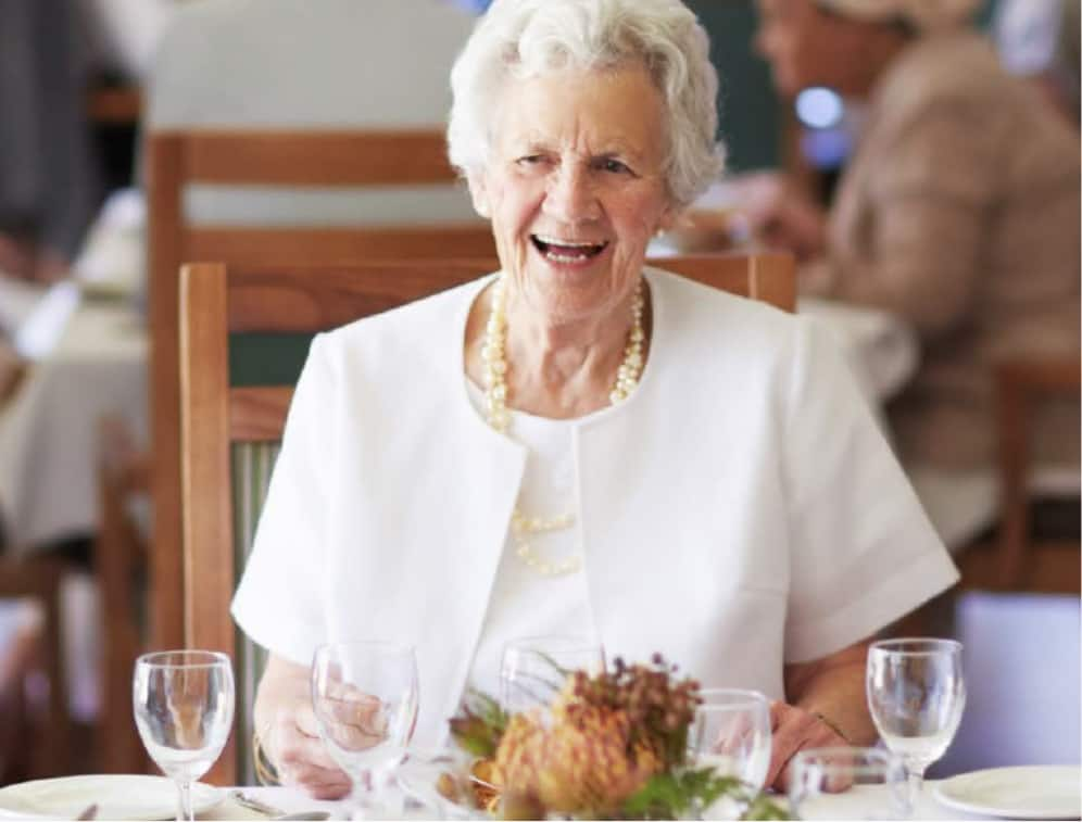 elderly woman enjoying dinner